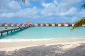 Holiday villa over blue ocean — Stock Photo