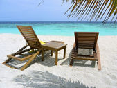Two beach chairs at ocean front — Stock Photo