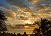 Caribbean sunrise with golden sky — Stock Photo