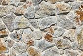 Gestapelde stenen muur achtergrond — Stockfoto