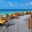 Deck chairs on sea view balcony - Stock Photo