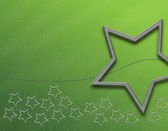 Green christmas background with stars — Stock Photo