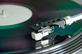 Dj turntable closeup with spinning record — Stock Photo