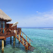 Water bungalow on tropical island — Stock Photo