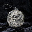 Royalty-Free Stock Photo: Silver christmas ball on black velvet
