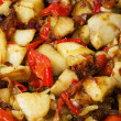 Stewed peppers with capers and potatoes - Stock Photo
