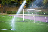 Watering in a football pitch — Stock Photo