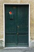 Antique green door — Stock Photo