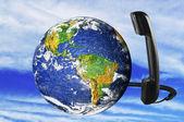 Phone with Earth globe — Stock Photo