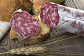 Salami and bread — Stock Photo