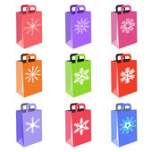 Shopping bags with snowflake symbols — Stock Vector