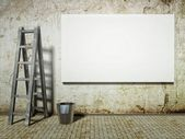 Blank street advertising billboard on dirty grunge wall with ladder and buc — Stock Photo