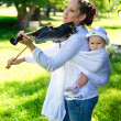 Royalty-Free Stock Photo: Play on a violin with the child
