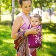 Mum with the child in a baby sling — Stock Photo