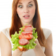 Royalty-Free Stock Photo: Young woman eating fast food