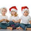 Christmas kids in Santa hat — Stock Photo