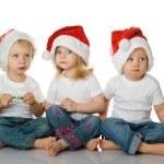 Christmas kids in Santa hat — Stock Photo