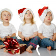 Royalty-Free Stock Photo: Three kids dreaming about christmas