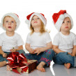 Stock Photo: Three kids dreaming about christmas