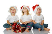Three kids dreaming about christmas — Stock Photo