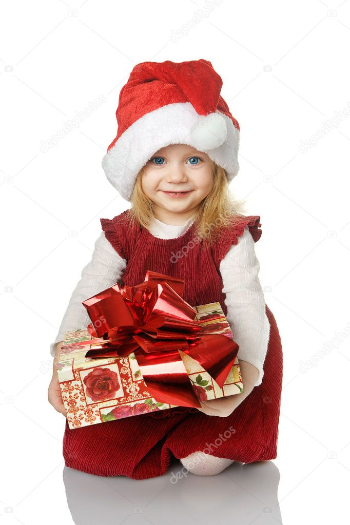 The girl in Santa hat with a gift. isolated on the white — Stock Photo #7586313