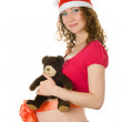 Stock Photo: The fine young pregnant girl in in Santa hat.
