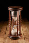 Hourglasses on a wooden surface — Stock Photo