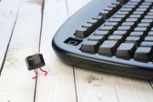 Escape key run away from a black keyboard — Stock Photo