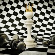 Stock Photo: 3d chess pieces on white and black background