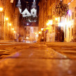 Night old town and bright street light - Stock Photo