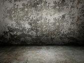 Grey old wall with light rays — Stock Photo