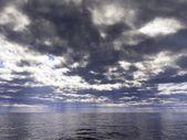 Dark clouds over the ocean — Stock Photo