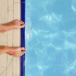 Pool water and feet - Stock Photo