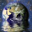 Planet Earth in the water — Stock Photo