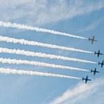 Civil airplanes making aerobatic manoeuvres — Stock Photo