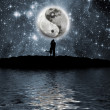 Lovers in front of the moon - Stock Photo