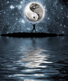 Moon with the sign of the yin and yang — Stock Photo