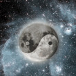 Moon with a sign of yin and yang - Stock Photo