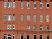 Facade of building in the evening with windows — Stock Photo