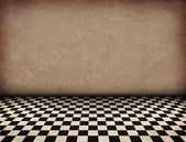 Vintage brown room with tiled black and white floor and artistic shadows ad — Stock Photo