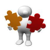 Logoman com duas peças de um quebra-cabeça — Fotografia Stock