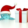 Arnold with Santa hat looking at a gift — Stock Photo