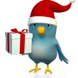 Bluebert with Santa hat and gift box — Stock Photo