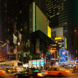 City life with Times Square at night - Stock Photo