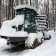 Snowbound timber vehicle - Stock Photo