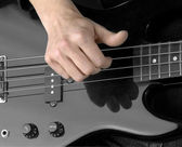 Hand and electric bass — Stock Photo