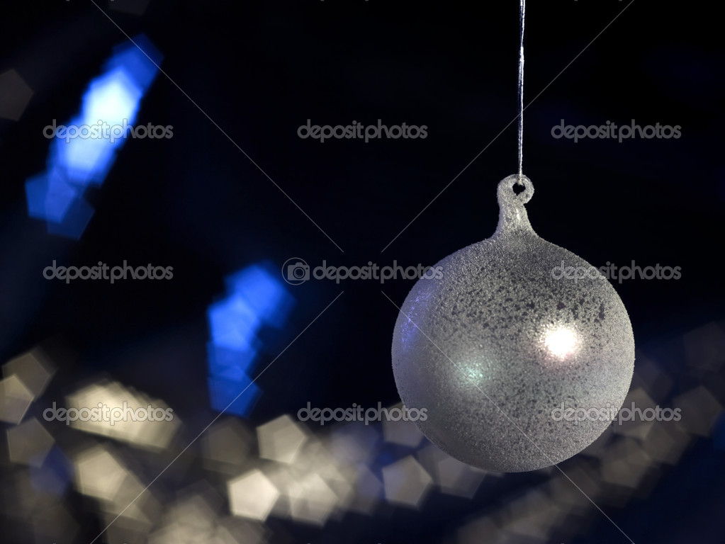 Christmas bauble in dark blurry back with copyspace — Stock Photo #7127921
