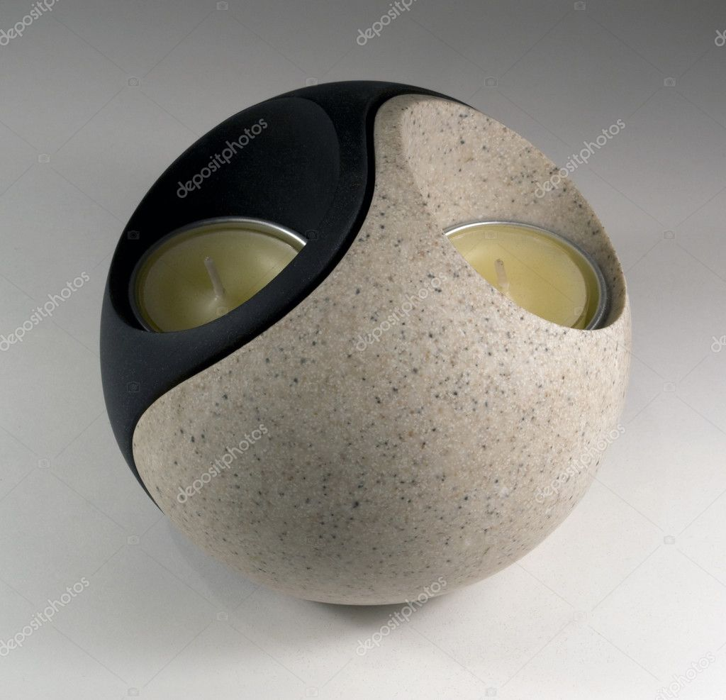 Studio photography of a Yin and Yang formed candleholder in grey back — Foto Stock #7128178