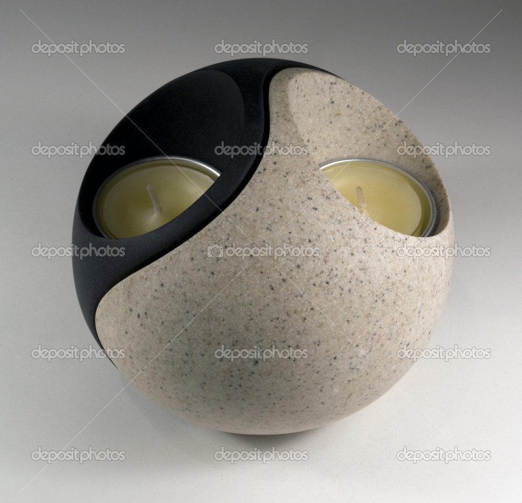 Studio photography of a Yin and Yang formed candleholder in grey back — Foto de Stock   #7128178
