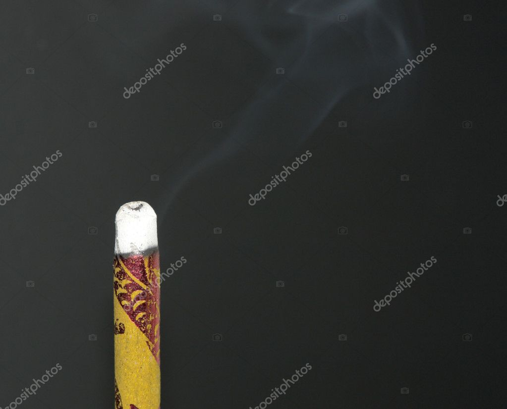 Burning joss stick closeup in dark back — Stock Photo #7128240